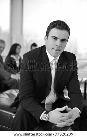 Businessman with his co-workers in office smiling