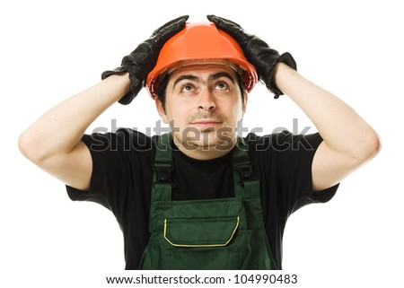 Businessman with his hands holding on to the helmet.