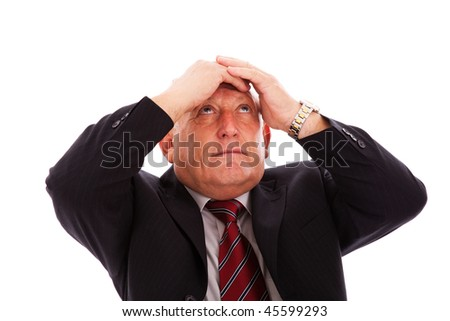 businessman with his hands in his head (isolated on white)