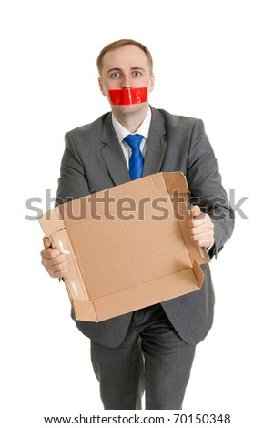 Businessman with his mouth sealed with red tape and cardboard in their hands