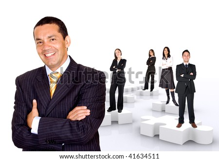 businessman with his teamwork on puzzle pieces isolated over a white background