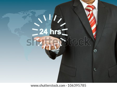 Businessman with 24 hour circle - stock photo
