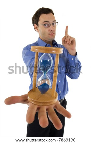 Businessman with hourglass aware of the approaching deadline - isolated - focus on hourglass