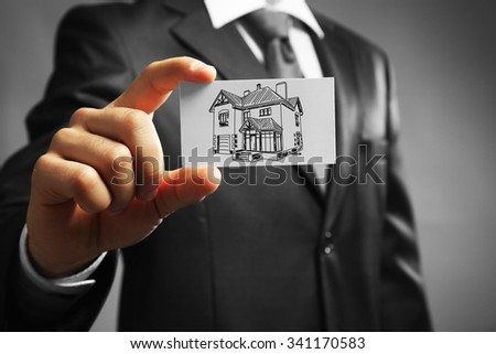 Businessman with house picture, concept real estate ストックフォト ©