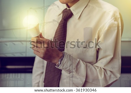 Businessman with illuminated light bulb concept for idea, innovation and inspiration #361930346