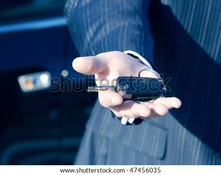 Businessman with key and car  for buisness travel - stock photo