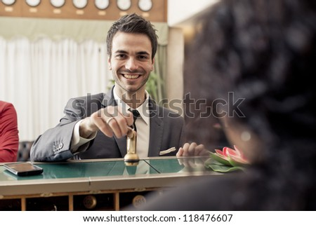Businessman with key at the hotel