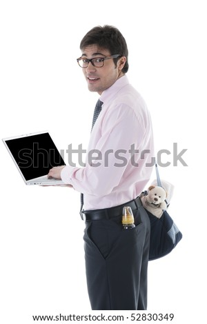 Businessman with laptop, milk bottle and diaper bag. Concept: multi-tasking, modern man