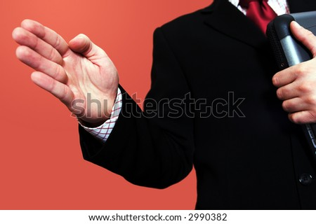 Businessman with laptop offering a shaking hand