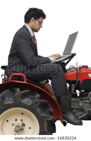 Businessman with laptop on a tractor, isolated in a white background