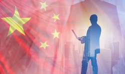Businessman with laptop on background of flag of China. Business in China. Silhouette of Chinese businessman. Entrepreneurship with People Republic of China. Business partnership concept with Chinese