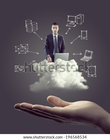Businessman with laptop on cloud with hand drawn technology icons and hand.
