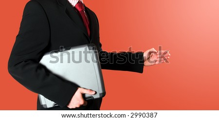 Businessman with laptop presenting or offering a shaking hand