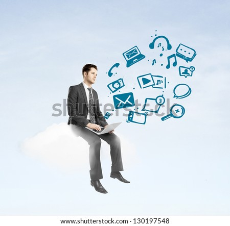 businessman with laptop sitting on cloud and social media icon #130197548