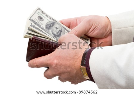 Businessman with leather wallet brown color with dollars. Isolated on white background