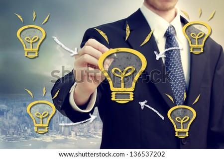 Businessman with light bulbs on a city backdrop