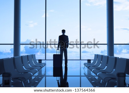 businessman with luggage in airport #137564366