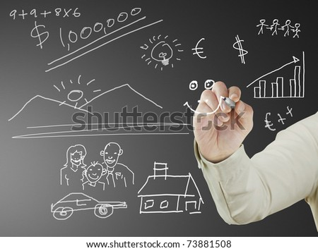 businessman with marker writing something on glass writeboard
