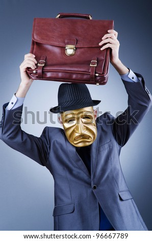 Businessman with mask concealing his identity