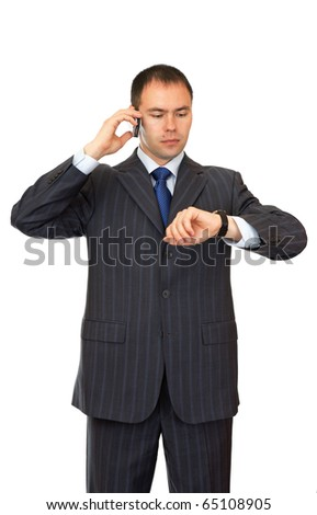 Businessman with mobile phone looks at his watch.