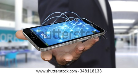 Businessman with modern mobile phone connecting different places of the world