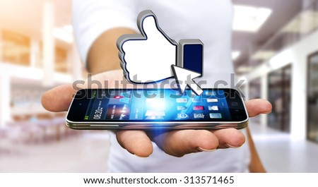Businessman with modern mobile phone in his hand liking a social network