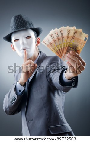 Businessman with money and mask