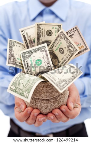 Businessman with money bag full of dollar banknotes - closeup