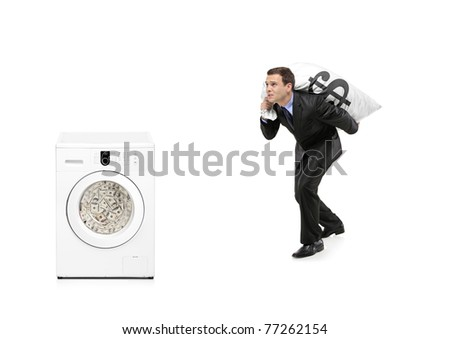 Businessman with money bag on his back going towards a washing machine isolated on white