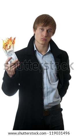 businessman with money burning