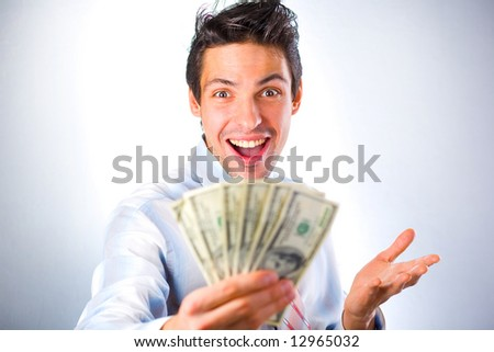 Businessman with money isolated in white background