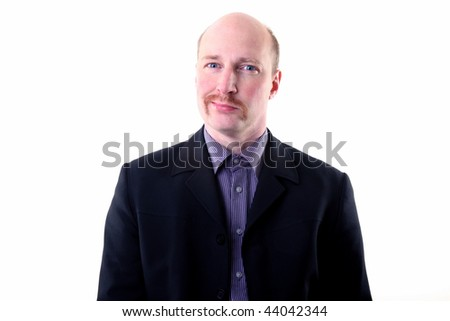 businessman with mustache looking smug or happy. male in suit isolated on white with beard and smiling expression