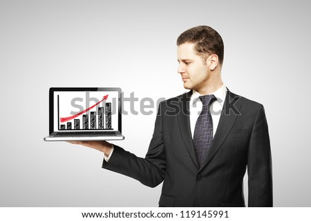 businessman with notebook and profit on screen