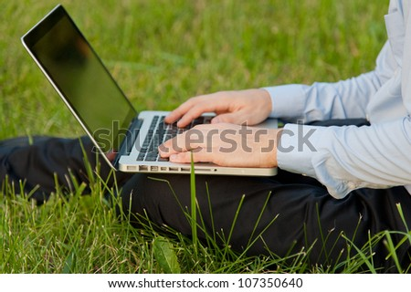 Businessman with notebook writes on the keyboard