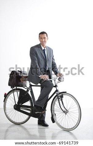 Businessman With Old-Fashioned Bicycle; Concept: I go Green