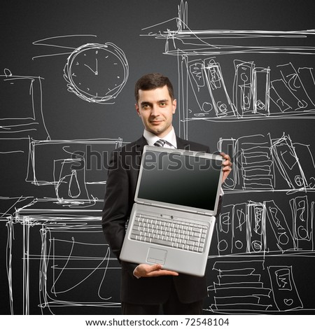 businessman with open laptop in his hands, smiles at camera