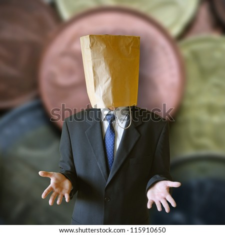 Businessman with paper bag  on a head.
