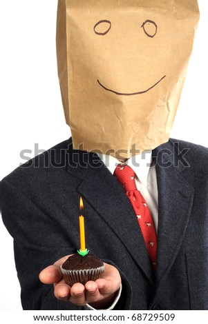 Businessman with paper bag on his head celebrating a birthday