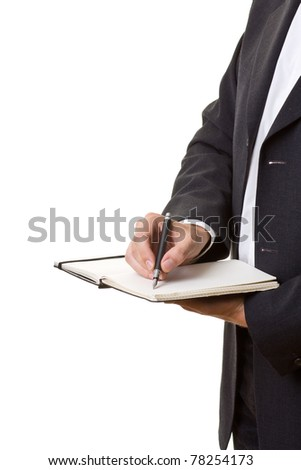 Businessman with paper notebook isolated on white