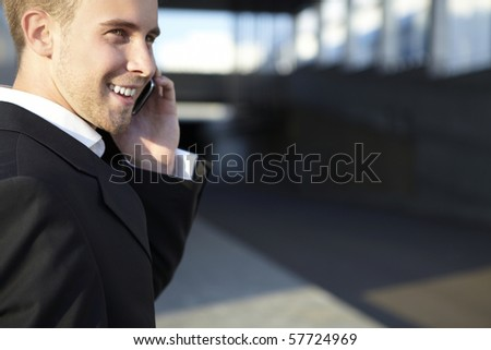 Businessman with phone - stock photo