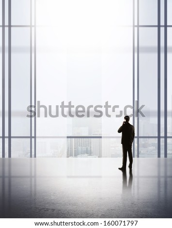 businessman with phone in airport