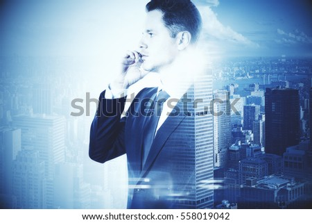 Businessman with phone on city background. Double exposure. Research concept