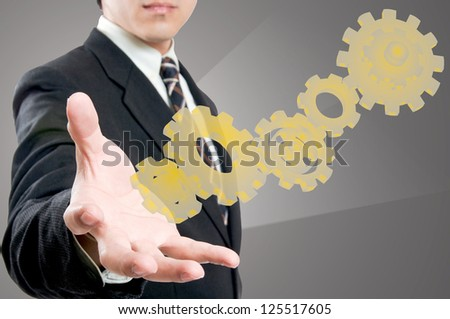 Businessman with power of team work concept in studio