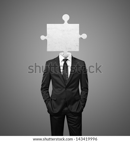 businessman with puzzle piece instead head