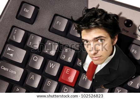 Businessman with red Euro symbol in a computer keyboard