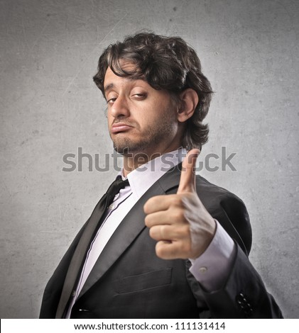 Businessman with satisfied expression and thumbs up