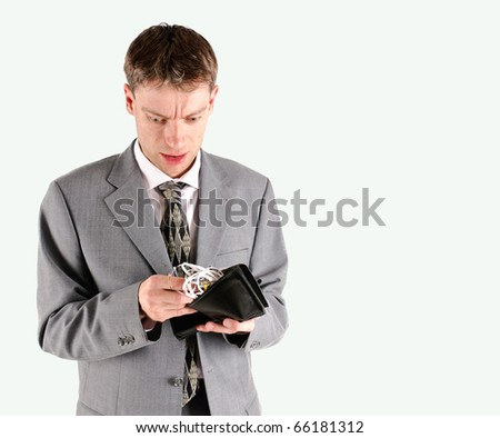 Businessman with shredded cash in wallet