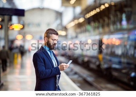 Businessman with smart phone #367361825