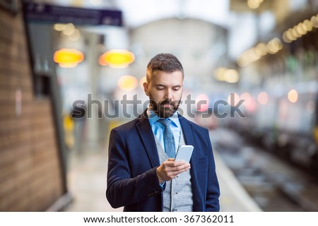 Businessman with smart phone #367362011
