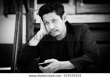 Businessman with smart phone,frustrated,Black and white #519559333